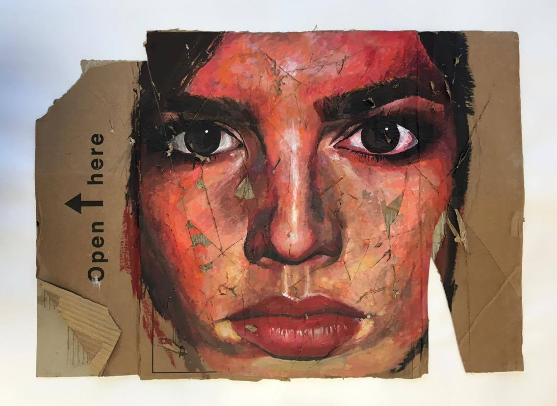 Artwork of close-up portrait painted on roughly torn cardboard.
